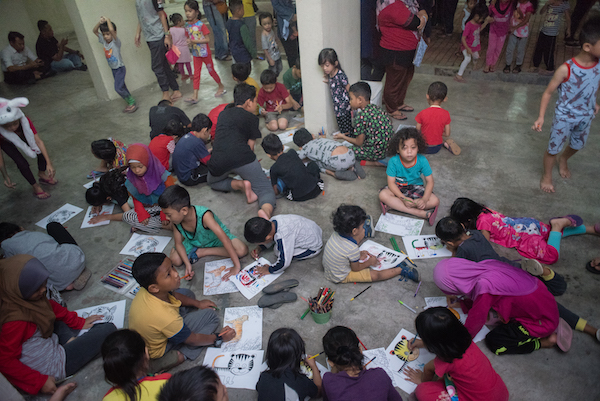 An activity with children at the community screening of DEMI PAYMITRA